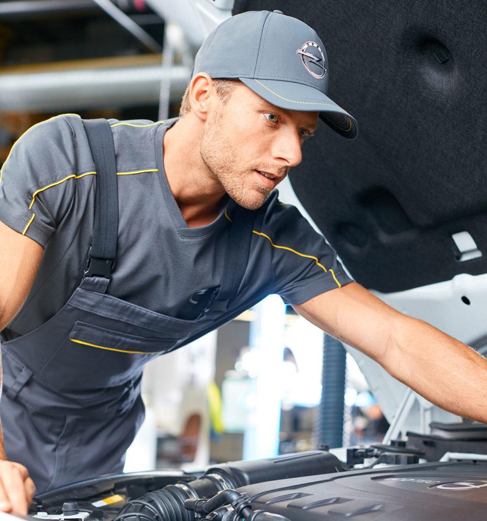 Fashionshooting Teamwearkollektion Arbeitsausrüstung Mechaniker Opel Blitz